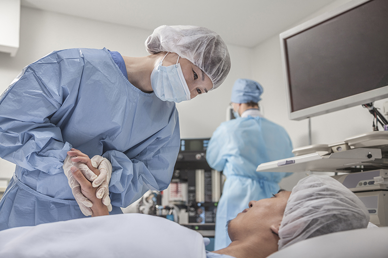 A physician attends to a surgery patient