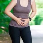 Woman with abdominal pain, injury while running, trauma during workout